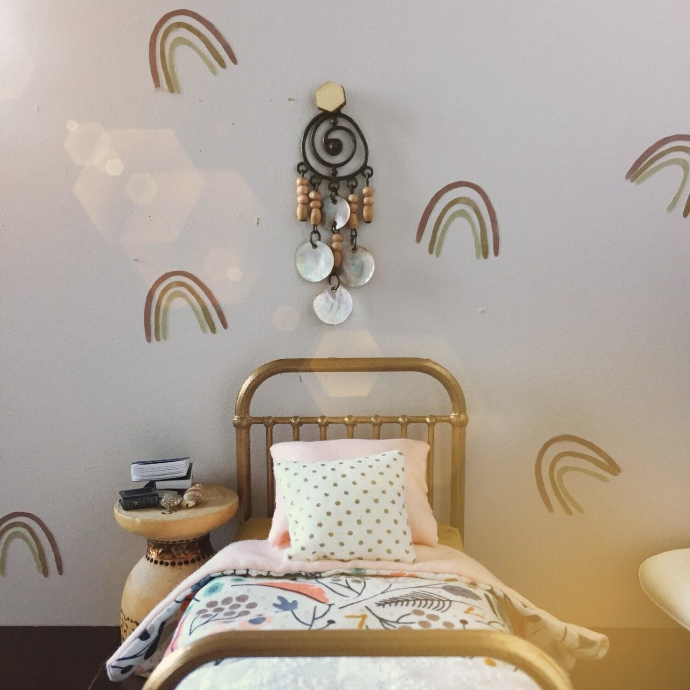 A close up of miniature rainbow wall decals in a doll's house.