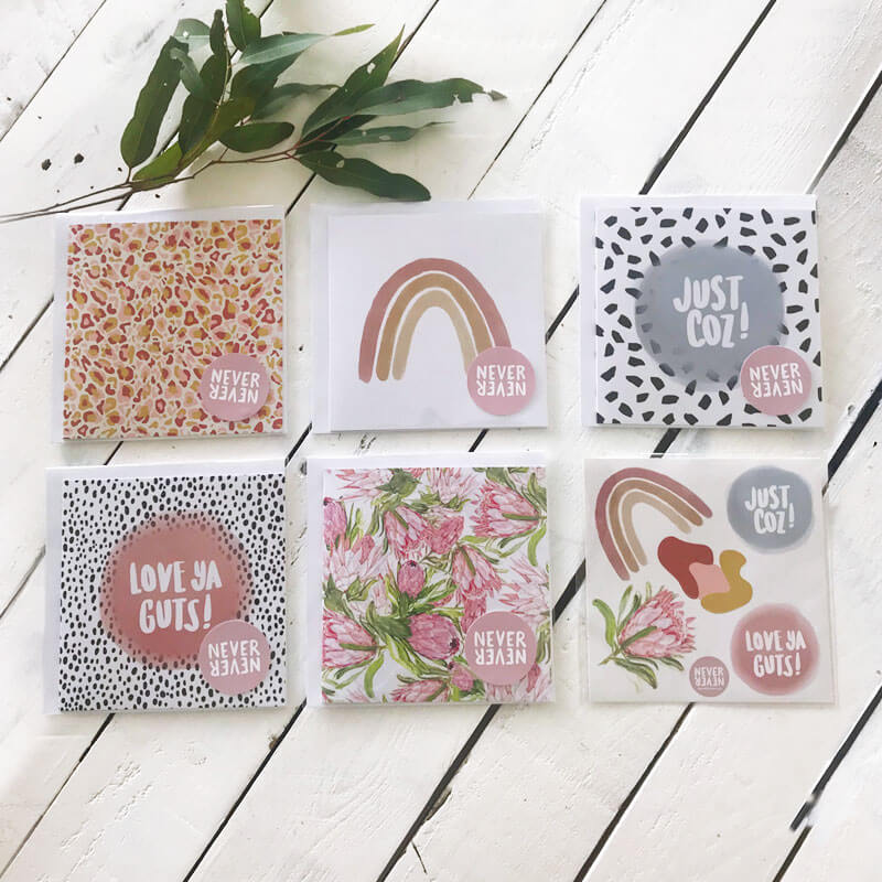 A collection of Never Never Greeting Cards featuring a rainbow, leopard print and protea flowers.