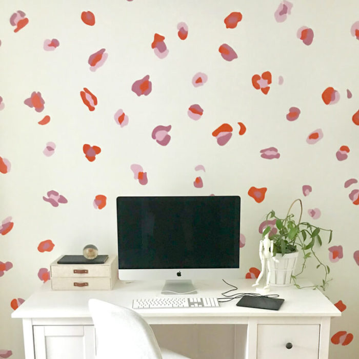 Leopard print wall decals in an office space.
