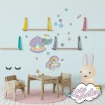 Sea creature wall decals featuring baby clam, rainbows and squid in a baby nursery.