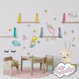 Sea creature wall decals featuring narwal, mermaid kitten and pufferfish in a baby nursery.