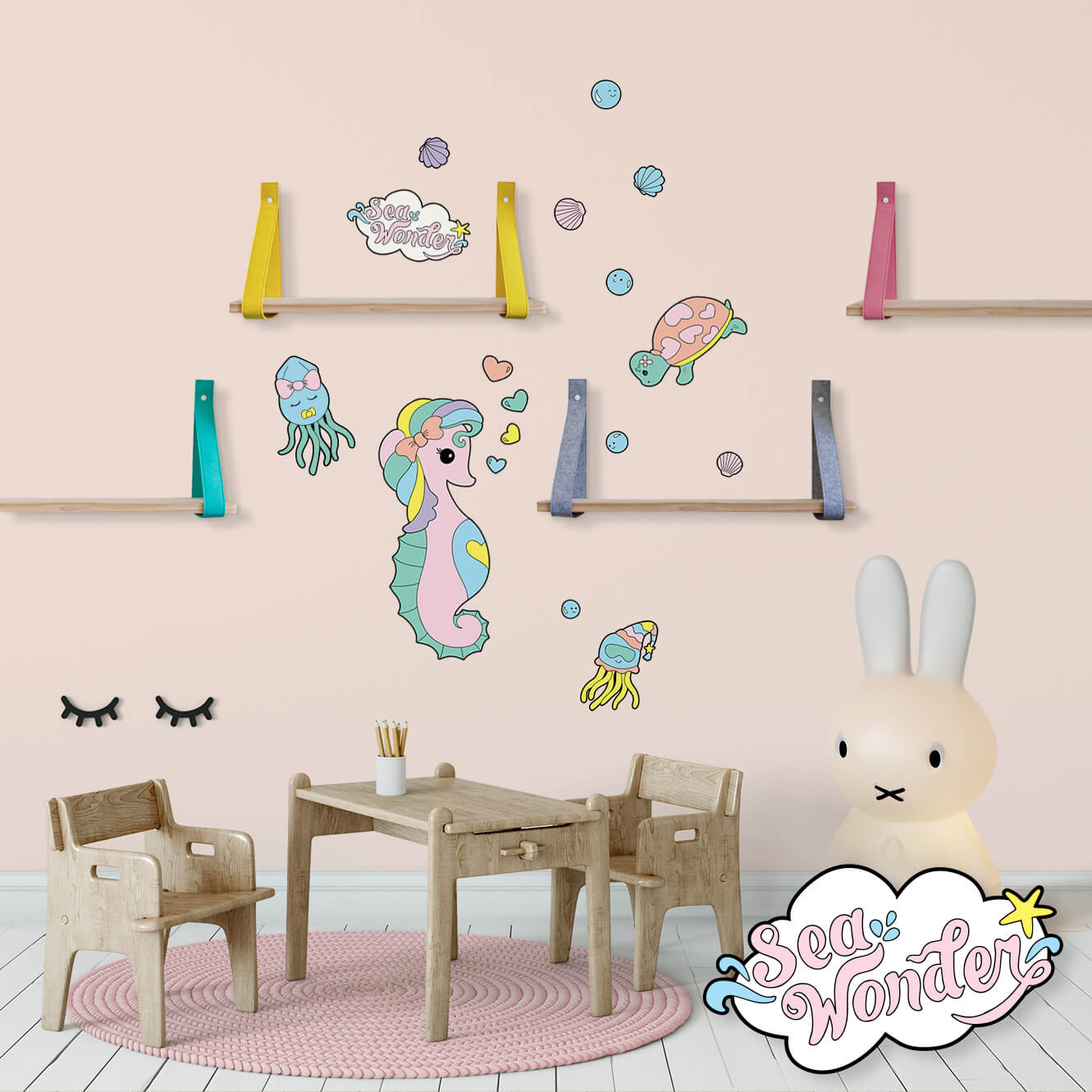 Sea creature wall decals featuring baby seahorse, turtle and squid in a baby nursery.