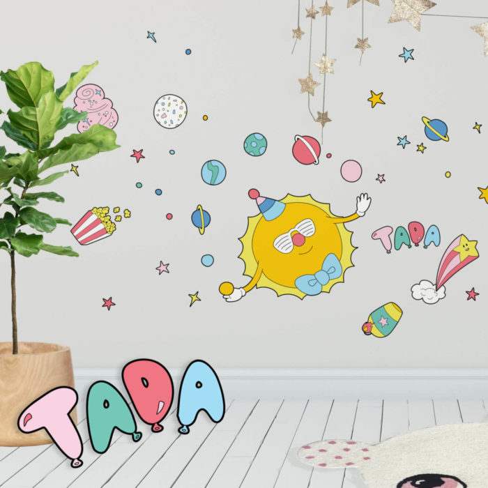 A fun kids room with Circus Space inspired wall decals featuring a juggling sun.