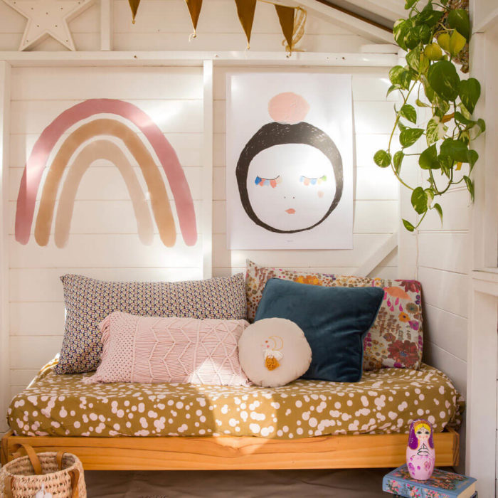 Boho inspired bedroom featuring our Large Rainbow Wall Decal.