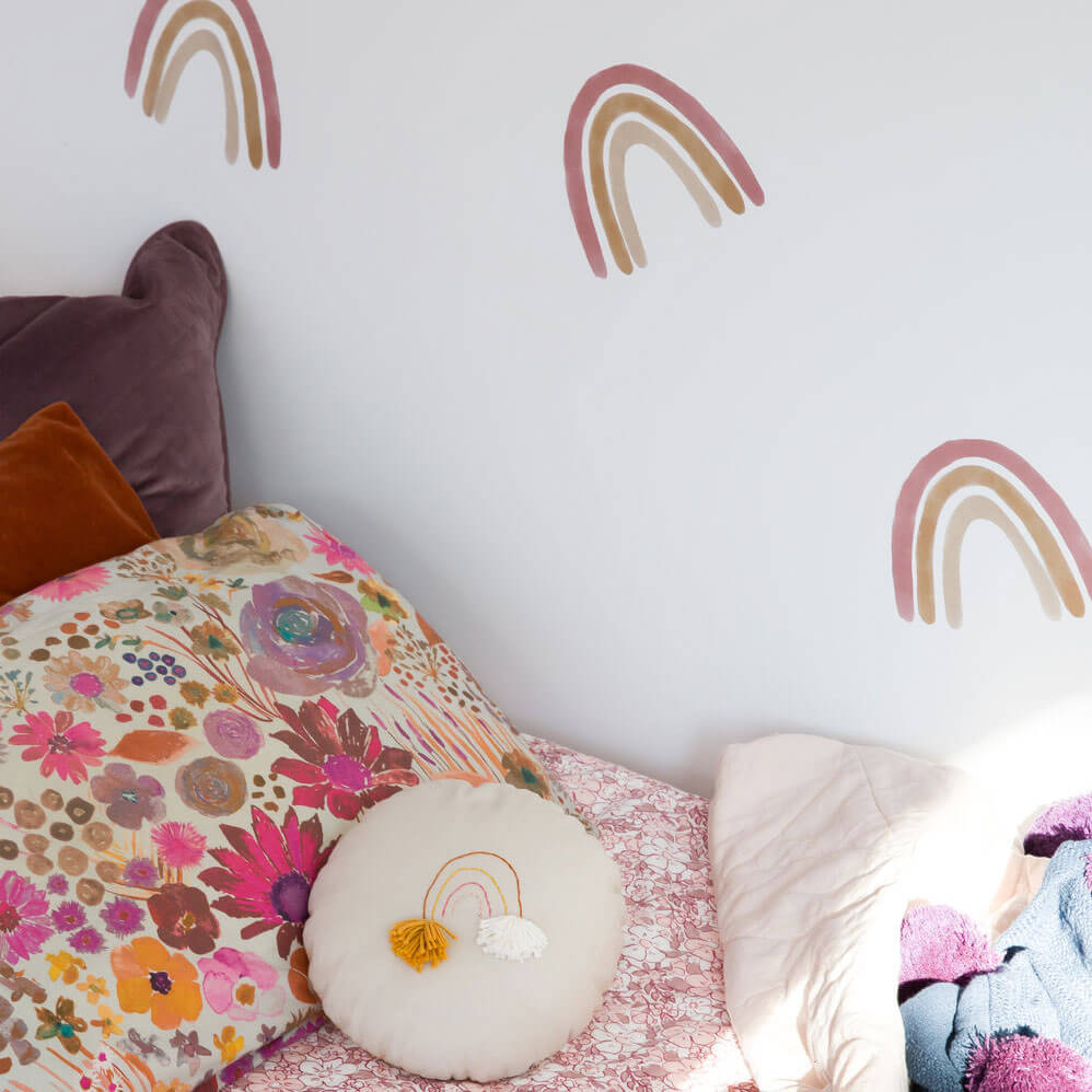 Close up of medium dusty rainbow wall decals in a girl's bedroom.