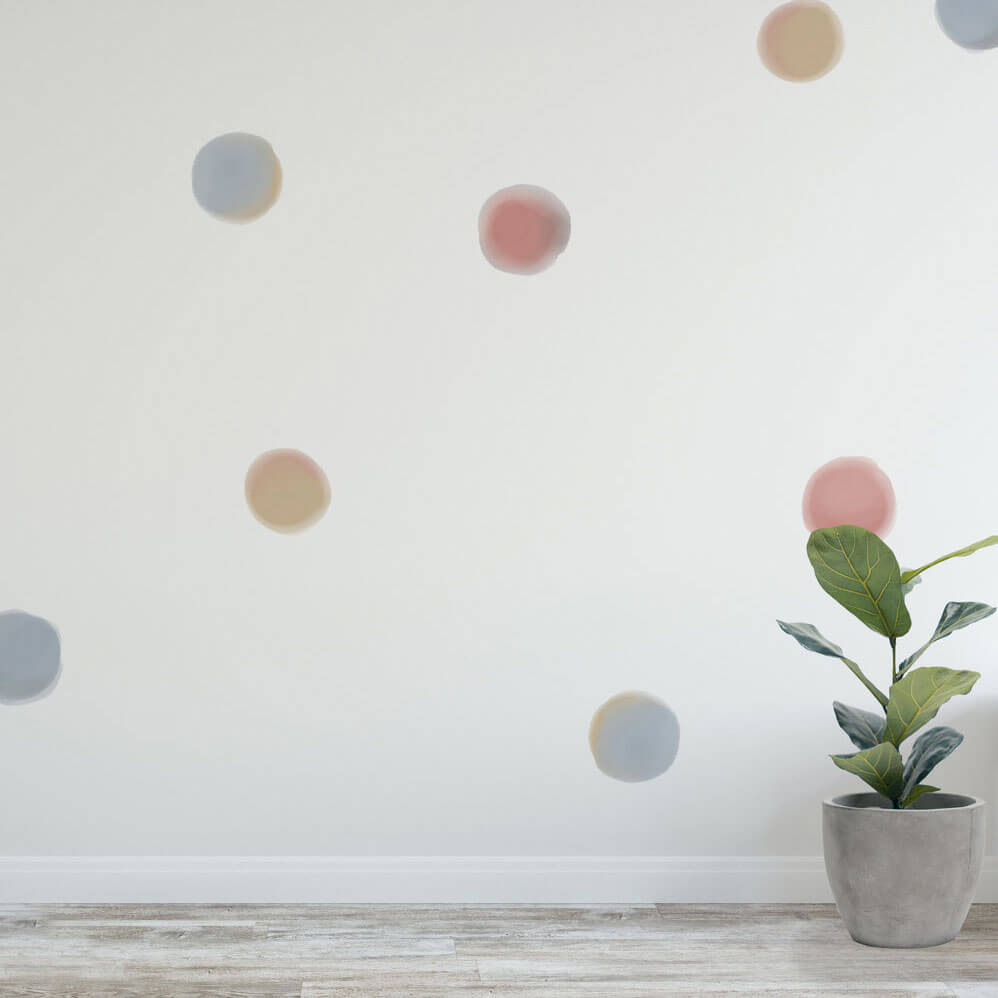 Watercolour spot wall decals in a gender neutral kid's room.