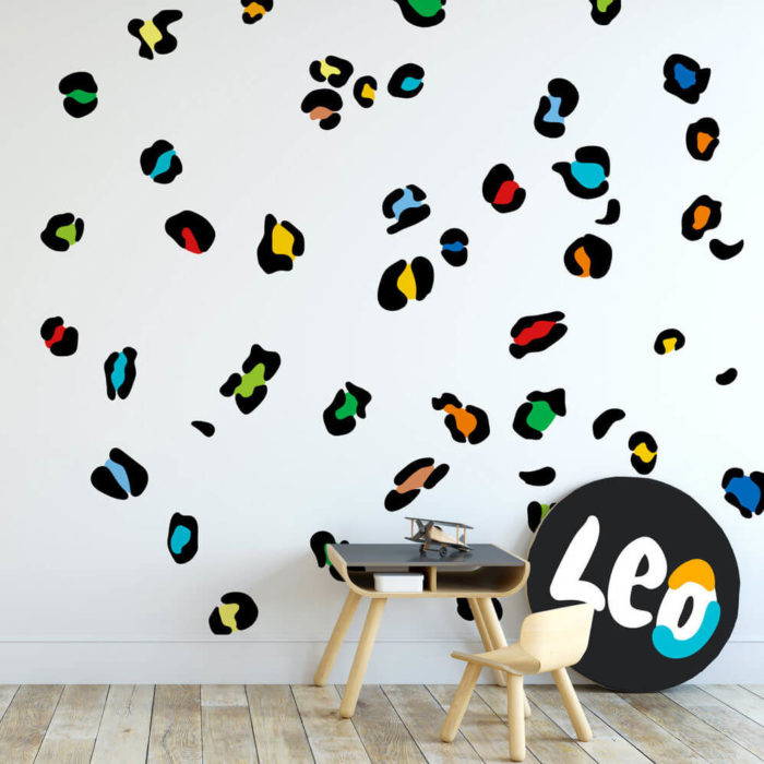 Leopard Print wall decals in a boy's playroom in black and rainbow colours.