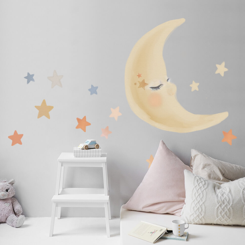Moon and stars watercolour wall decal in a nursery.