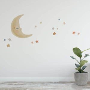 Moon and stars watercolour wall decals in a child's nursery.