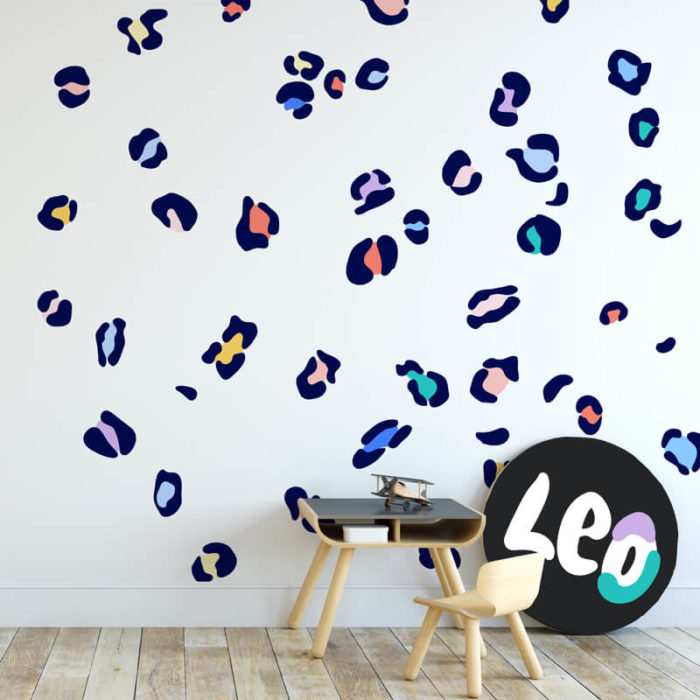 Leopard print wall decals in navy and rainbow colours.