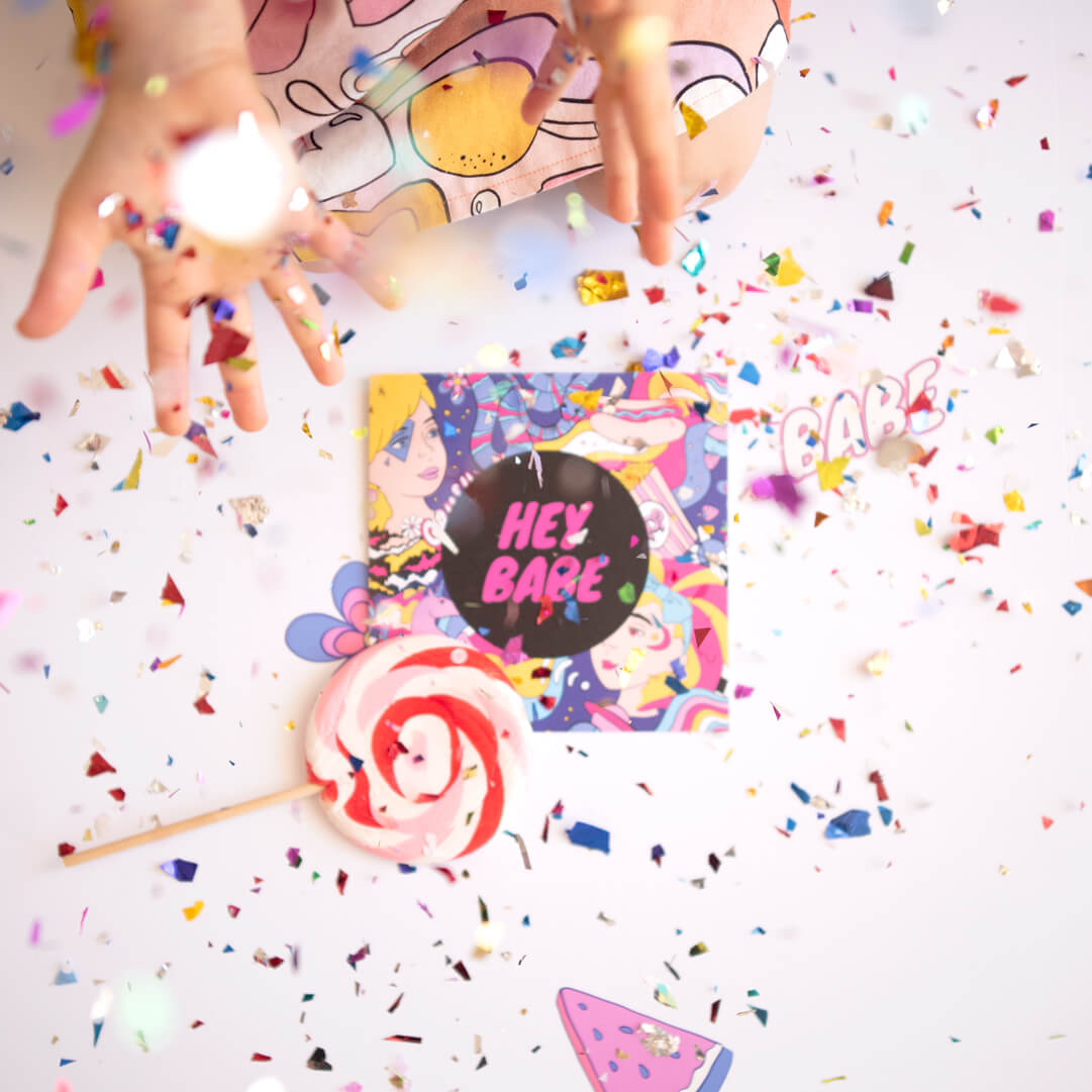Confetti thrown over a unique greeting card.