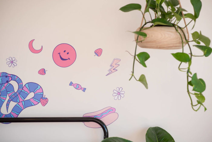 Detail of pink and purple wall decals.