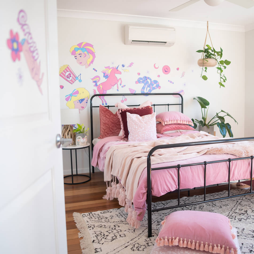 Girl bedroom decor with wall decals in pink, purple and yellow colours.