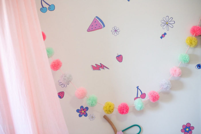 Detail of wall decal and wall art in a girl's bedroom.