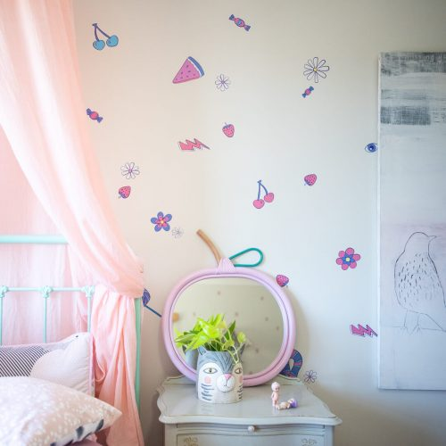 Close up of wall decals in a girly bedroom.