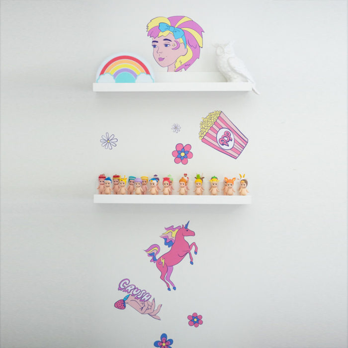 Shelf dressing in a girls bedroom.