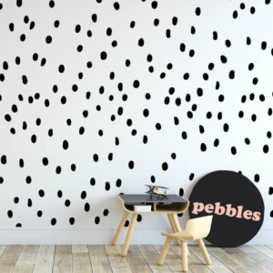 Monochrome wall decals in the shape of pebbles.