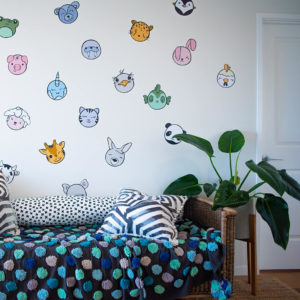 Kawaii inspired wall decals of animals for a nursery.